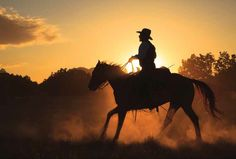 New Mexico cowboy rides into the sunset on a ranch near Santa Fe. Photograph By Ralph Lee Hopkins #summeroftreasures