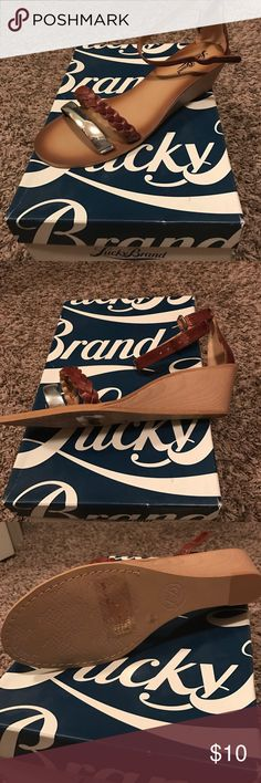 Lucky Brand tan leather wedge sandals. NIB! Lucky Brand tan leather wedge sandals. NIB! Size 8.5 Lucky Brand Shoes Flats & Loafers