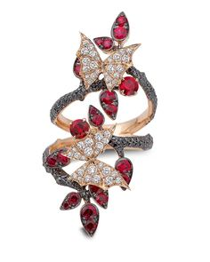 I love Stephan Webster ANYTHING. Stephen Webster 'Fly By Night' Couture long finger ring set in rose gold, with rubies and black and white diamonds.