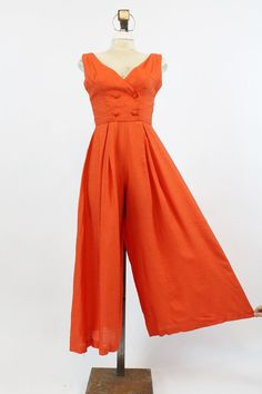 Stunning 1960s does 1930s beach pyjamas! Done in a tomato red raw silk blend material. Decorative double breasted styled bodice. Center back zipper.