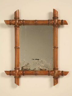 petite antique continental mirror in faux bamboo frame