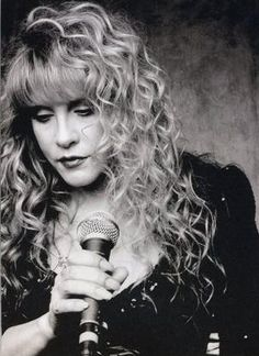 Stevie Nicks. She's a hot damn crazy ass mess and I love her.  The only concert ticket I've ever saved.