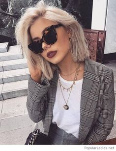 White top, jeans and plaid blazer