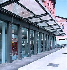 Retail space with corrugated glass awning.