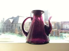 Decorative Vintage Purple Glass Bottle - hand blown glass oil or vinegar cruet with cork and interesting pyramid shape. $12.50, via Etsy.