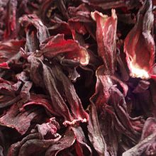Hibiscus tea -- easy to make and super cheap ($4-5 for a giant bag at the Mexican grocery store)