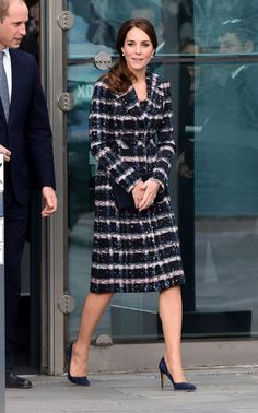 Prince William, Duke of Cambridge and Catherine, Duchess of Cambridge leave after touring the National Football Museum during their visit to Manchester on October 14, 2016 in Manchester, England.