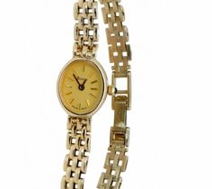 """Bulova T7 Lady's Wrist Watch  Bulova T7 Petite Lady's swiss quartz wrist watch, in 14K Yellow Gold.  6 1/4- 6 1/2 length,    5/8"""" wide extra links included. One year guarantee on the movement. Item Number: WOO630"""