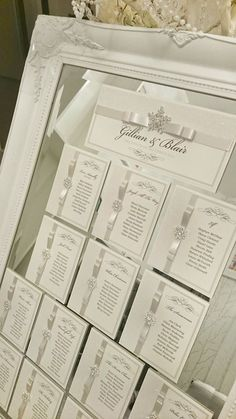 Couture Mirrored Chritmas/Winter wedding table plan, with ivory Satin ribbon and cystal diamante snowflakes