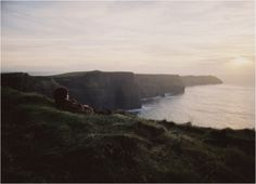 Ireland's Coast by anthropologie. I like the person there soaking it in, as if they are a part from which the cliffs are made.