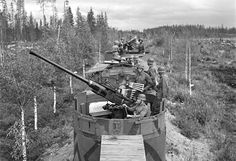A Finnish armored train en route to undisclosed destination. In the foreground the AA gun is a Swedish Bofors 40-mm, one of the most widely deployed by both the Allies and the Axis during WW2. The cannon remains in service as of 2013 making it both one of the longest-serving artillery pieces of all time as well as one of the most widespread. Bofors itself is, since March 2005, a part of BAE Systems AB.