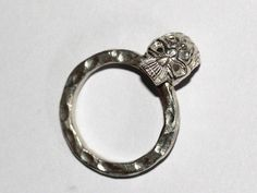 ONE OF A KIND sterling skull ring.  The lines on the skull are not only work as decoration but also represent fire and strength. As in ancient time, soldiers and warriors believe skull can bring Strength and Courage to themselves, specially when secret patterns are carved on skulls.  I pay lots of attentions in details. Even the band is specially hand textured, and the band is thick enough, give a feeling of toughness. Our Website: http://hongxistudio.com/