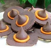 Vanilla cookies with chocolate, one dab of orange frosting, place a kiss on top and you're sweetly spooky (: