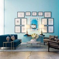 Living Room With  Turquoise Color Wall And Wall Hanging Pictures And Mirror And Console Table And Blue Sofa And Brown Arm Chairs And Round Coffee Table And End Table , Decorating Ideas With Turquoise Color In Furniture Category