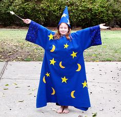 After compiling a list of twenty or so costume ideas, Natalie settled on being a wizard for Halloween. We haven't entered the world of Harry Potter yet, so her idea of a wizard is pretty traditional. She knew she wanted a big cloak with moons and stars all over, a tall pointy hat, and a magic wand. Her wizard cloak is more of a dress,