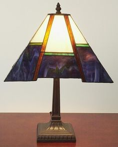 This Mission-style table lamp has been handcrafted using methods first developed by Louis Comfort Tiffany.