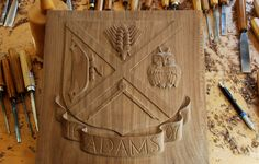 Work in progress For a customer from North Rhine-Westphalia (Germany), the ADAMS family coat of arms Walnut, total relief 1cm Will be framed, a decorative panel to hang on a wall. http://www.patrickdamiaens.be