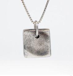 We found an artist who makes really beautiful custom thumbprint jewelry. Lovely keepsake.