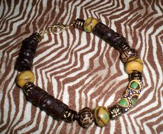 A personal favorite from my Etsy shop https://www.etsy.com/listing/176895821/asante-and-sankofa-trade-bead-bracelet