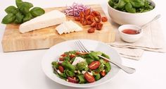 Mature goats' cheese, tomato & pine nut salad - perfect light lunch.