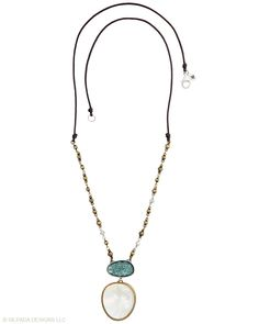 This is on my wish list -- it is reversible:  one side is blue, and the other is a neutral earth tone.  Silpada Oyster Bay Necklace  N2455