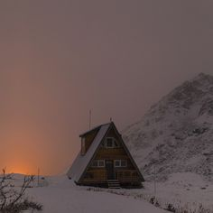 """"""" mikeyhuff: City light pollution peaking up behind a hidden cabin perched upon Hatcher Pass """""""
