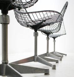 Rare set of four wire chairs dedigned by Charles and Ray Eames in 1958 for Herman Miller, USA. Black wire mesh shell on a polished aluminium contract base    1600 e x 4