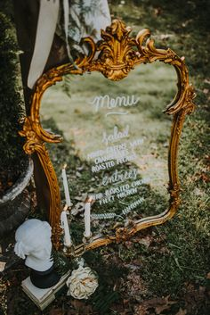 Antique gold mirror used to display the reception menu | Image by The Marions