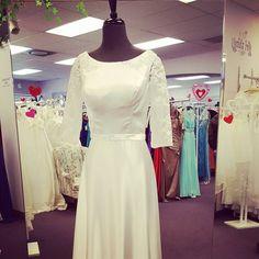 Simple but elegant informal wedding dress.  #lessismore #beachwedding  #destinationwedding #boulevardbridalprom #stgeorgeutah