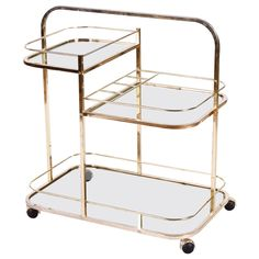1970s French Vintage Brass and Glass Bar Cart | From a unique collection of antique and modern bar carts at https://www.1stdibs.com/furniture/tables/bar-carts/