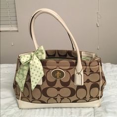 Madeline Coach purse 100% genuine. Leather trim. Barely used and outside is in great condition with minimal signs of use around white leather. See pic 4 on white leather, has a little blue tint on handle and white trim isn't completely white. Inside has a faint smudge. Bag is a rather large size. Will show additional pics upon request. Trade value $325 Coach Bags Shoulder Bags