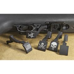 Large Ruger 10/22 Mag Release • From left to right: Flag, Biohazard, Jolly Roger, Punisher, Blank