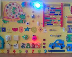 Artículos similares a Tablero ocupado, madera juguetes, actividad, tablero sensorial, juguete educativo de Montessori, juguete de madera, tablero de cierre en Etsy