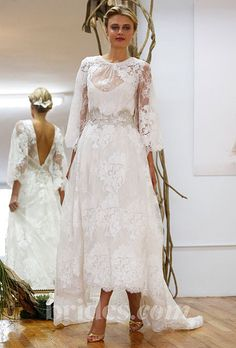 Brides.com: Wedding Dresses with Long Sleeves from Fall 2013. Wedding Dress with Long Sleeves: Elizabeth Fillmore. Embroidered lace gown by Elizabeth Fillmore    See more Elizabeth Fillmore wedding dresses in our gallery.