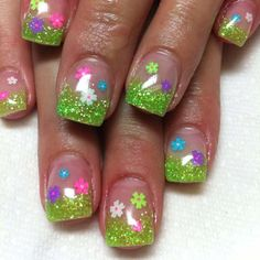 Easter Nails....simple: green glitter, and pastel flowers made with a toothpick or thin nail art brush--perhaps better on white than clear.