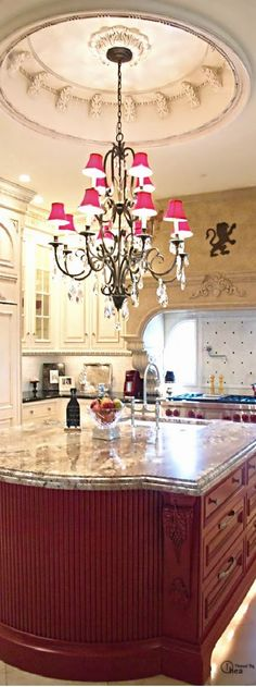 Rachel Woodhouse saved to HomesI think I'd do back chandelier lamps instead of the pink to give it depth. #homedesignideas #kitchendesign #kitchendecor