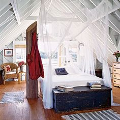 """Mosquito net used as """"curtains"""" around the bed....oh yes!"""