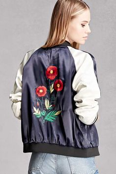 A satin souvenir jacket featuring a back floral embroidery, colorblock raglan sleeves with stripes, a zipper front, slanted front pockets, and a ribbed trim with varsity stripes. This is an independent brand and not a Forever 21 branded item.