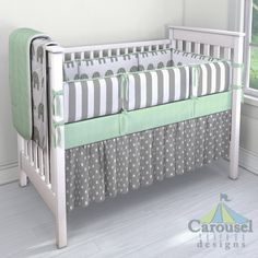 Crib bedding in White and Gray Elephants, Solid Mint Minky, White and Gray Stripe, Gray and White Polka Dot. Created using the Nursery Designer® by Carousel Designs where you mix and match from hundreds of fabrics to create your own unique baby bedding. #carouseldesigns
