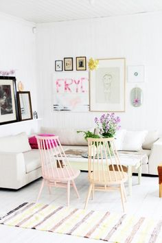 White living room with pastel pop.