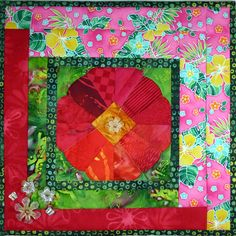 Dresden Hibiscus Flower by Shelley Swanland. It has 3D corners that are rolled during quilting.