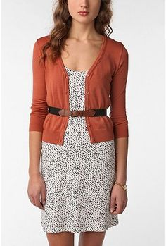 Sweaters. Must have staples for your work wardrobe. Use a small belt to tie the look all together.