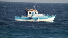 klein vissers bootje op de grote oceaan
