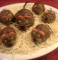 This is a fun, inexpensive, creepy Halloween entree that will gross out and impress your dinner guests. It is mini meatloaves baked in tomato sauce that are shaped like rats with cheese in the middle. When you cut it open, gooey cheese will come oozing out. Garnished with a spaghetti noodle tail and carrot ears, these pests are sure to be a devilishly delectable dinner.