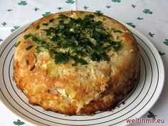 Sauerkraut-Kartoffel-Auflauf mit Speck und Rauchfleisch.