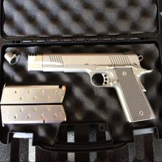 The Kimber Beast!  Kimber 1911 Stainless Classic .45acp, stainless compensator, ultra slim titanium grips, Trijicon night sights, 2 Chip McKormick 8 rd mags