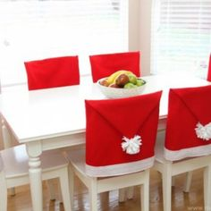 Santa Hat Chair Covers {Christmas DIY Decor} step by step instructions plus this site has tons of extra holiday ideas.