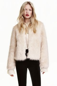 Faux fur jacket: Short faux fur jacket with concealed hook-and-eye fasteners at…