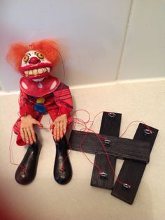 Creepy clown marionette, polymer clay over a wire frame