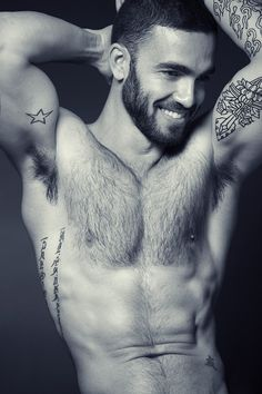 Such a sexy man... , tight body, tats, and beard... but the smile is what really caught my eye